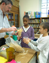 Photo of Bob Imber with his fourth-grade students working on designing solar ovens.