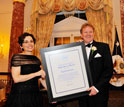 Photo of NSB's France C�rdova presenting NSB's Public Service Award for a group to Dennis Bartels.