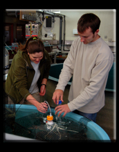 Two students working in the aquarium at McMurdo Station.