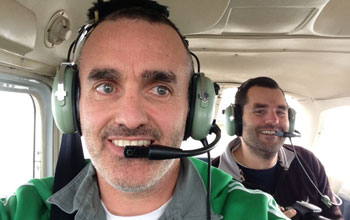 Scientists Chris Reddy (foreground) and Dave Valentine in a plane