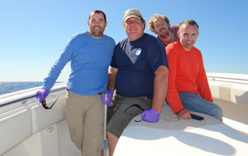 Photo of scientists on a boat: Valentine; Nelson; Kellermann, Reddy.