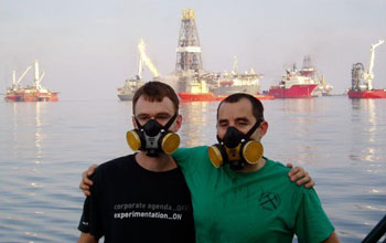 Photo of John Kessler and David Valentine in front of the Deepwater Horizon Gulf oil spill.