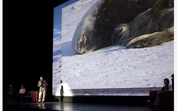 Photo of Randy Davis discussing his research on Weddell seals.