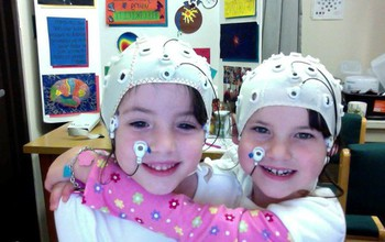 Kids wearing EEG caps.