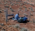Joe Leon, a former graduate student at New Mexico Tech, is shown servicing a RISTRA seismic station.