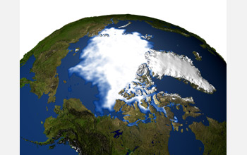 Satellite image from north pole showing Arctic sea-ice, ice covered Greenland, and adjacent areas.
