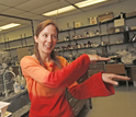 Photo of Elizabeth Harbron demonstrating the dance of conjugated polymers.