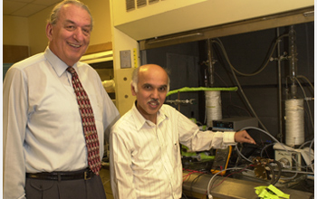 Photo of Nobel Laureate George A. Olah and G. K. Parkash who work together on recycling CO2.