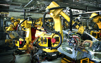 Photo of robots at work on assembly line in a car factory