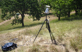 A wireless video camera records in the field