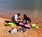 Scientists screenwashing Eocene sediment to recover microvertebrate fossils.