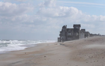 Photo of rising seas lapping at a house in the film Nights in Rodanthe.