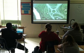 Photo of students watching a transportation construction role model video.