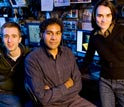 Photo of Chris Moon (left), Hari Manoharan and Laila Mattos (right), the subatomic writing team.