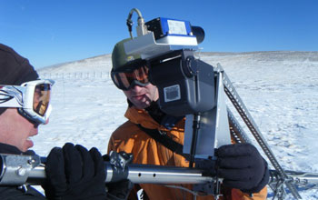 Image of a scientist field-testing new instrumentation to accurately measure snow.