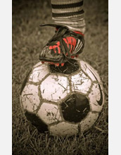 Photo of a soccer player's foot on the ball.