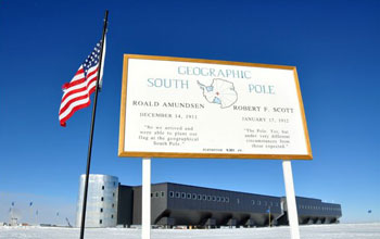 Image of a sign at the geographic South Pole located at 90 degrees south latitude.