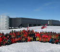 Norwegian Prime Minister Jens Stoltenberg and personnel at the geographic South Pole.