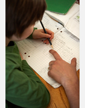 Photo of student doing math.