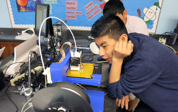 student watching 3-D printer
