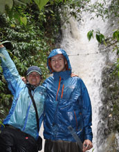 Photo of researchers Kayce Anderson and Brian Gill at a site beneath a waterfall along the Oyacachi.