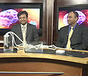 Photo of two researchers and webcast host in the studio.