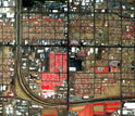 Map of vegetation (red), soil (brown, tan), built materials (white) in a south Phoenix neighborhood.