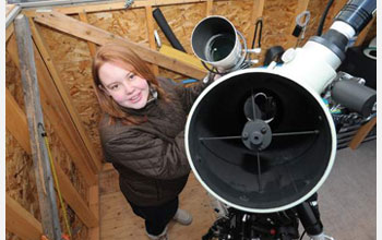 Photo showing Caroline Moore at work in her home observatory