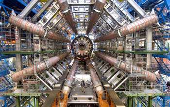 Photo showing a man standing inside the ATLAS Barrel Toroid Magnet at CERN.