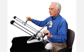 Photo of Jim White demonstrating the use of the Tailwind device.