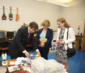 Gavin Garner showing equipment at UVa's lab to NSF's Joan Ferrini-Mundy and Susan Singer.