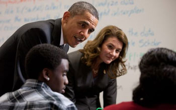 Photo of President Obama and Melinda Gates visiting a TechBoston classroom.
