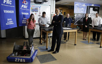 President Obama tours a classroom at Manor New Technology High School in Manor, Texas