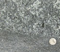 Crystals in sheet-like basalt compared to the size of a quarter, near Rapidan, Va.
