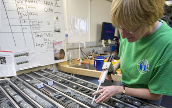 Researcher Margaret Hastedt labels pieces of core collected during Expedition 324.