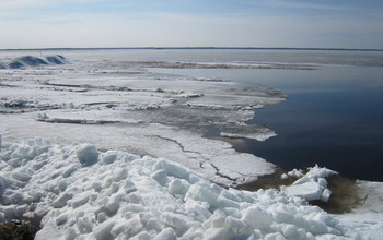 Ice-covered lakes warm faster than those with open water.