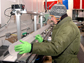 Measuring and cutting a WAIS Divide ice core at the National Ice Core Lab near Denver.