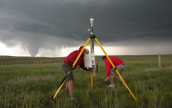 Photo of IGERT trainees deploying a portable weather station.