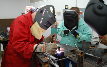 Two students learning welding skills at Weld-Ed.