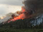 Smoke billows from the Beaver Creek Fire west of Walden, Colorado