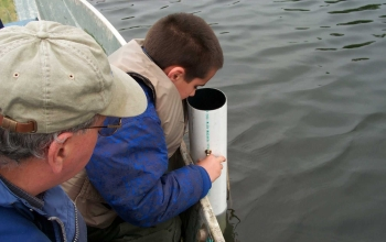 Citizen volunteers have been trained to measure water clarity with a Secchi disk and view tube.
