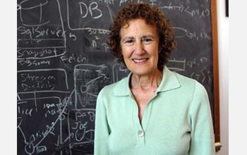 Photo of Barbara Liskov of MIT in front of a chalk board.