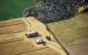 Aerial view of a rural farm surrounded by cornfields in the Yahara watershed.