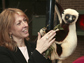 Photo of Duke University Lemur Center director Anne D. Yoder with a Coquerel's Sifaka.