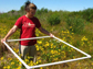 Anya Hopple collects wetlands data