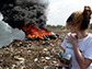 Heidi Vreeland looking at roadside trash burning in India