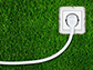 image of an outlet in the grass