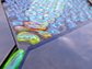 the mechanism by which foam with bubbles in two distinct sizes is created in a microfluidic device