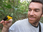 Matthew Fuxjager with a golden-collared manakin