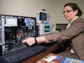 researcher measures electromagnetic emissions